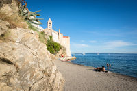 City Beach of Rab in Croatia with typical rocks