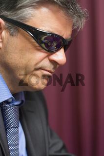 Man wearing sun glasses at the casino