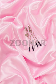 Nipple clamps on pink top view.