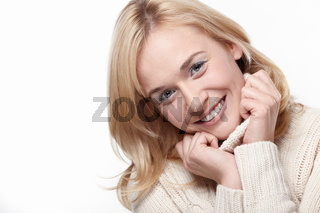 Attractive girl in a sweater with a white background