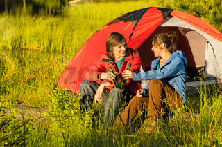 Camping teenagers drink beer outdoors