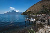 Coastal view with jetty along the village on lake Atitlan in Santa Cruz la Laguna, Guatemala