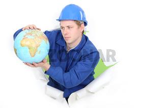 Tradesman holding a globe
