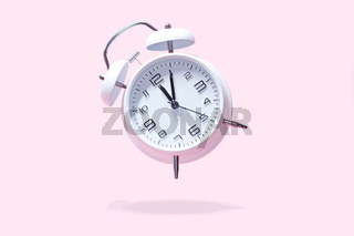 White bell alarm clock hovering over pastel pink background. 5 after 12 clock, countdown too late