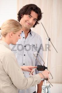 Couple fixing television aerial