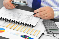 Analyzing  financial documents  in the office