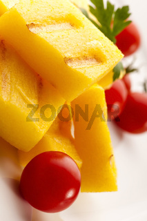 Polenta taragna with sauce and tomatoes