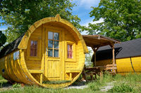 Wooden sleeping barrel to spend the night on a campsite in Germany