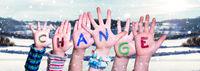 Children Hands Building Word Change, Snowy Winter Background