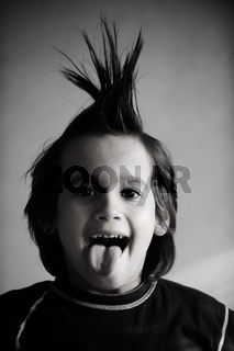 Portrait of kid with funny hair