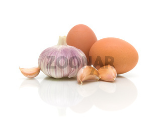 garlic and eggs close-up on white background