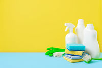 House cleaning product on yellow blue bg, copy space