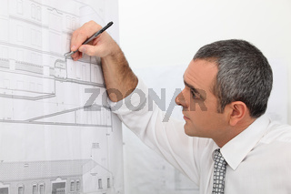 Architect working on a blueprint