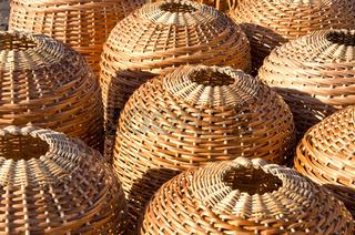 Wicker handmade wooden basket sell in outdoor city street market fair.