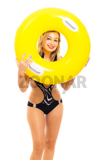 Happy woman in swimsuit with rubber ring