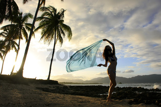 Silhouette of young woman standing at Las Galeras beach