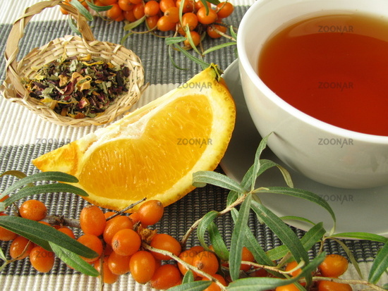Tea with fruits of sea buckthorn and oranges