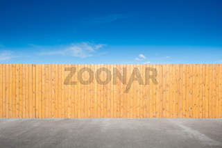 yellow fence and bue sky background