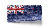 New Zealand flag on a piece of cloth on a white background