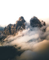 Aerial moody landscape of Tre Cime di lavaredo mountains in cloudy day, Dolomites, Alps, South Tyrol, Italy.