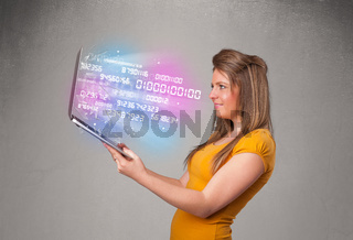 Casual woman holding laptop with exploding data and numers