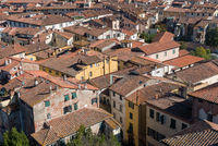 Cityscape with rooftops from Torre Ginigi tower Lucca town. Tuscany central Italy