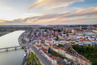 Coimbra drone aerial city view at sunset with Mondego river and beautiful historic buildings, in Portugal