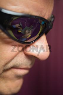 Man is wearing sun glasses