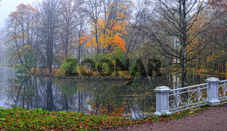 Autumn landscape with river and bridge in Catherine park, Pushkin,