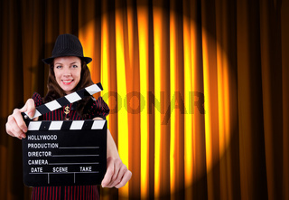 Woman gangster with movie clapper