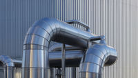 Pipelines in front of a trapezoidal sheet metal wall, gas power plant, Germany