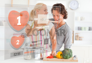 Cute couple making dinner using interface instructions