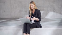 Blond businesswoman making video call