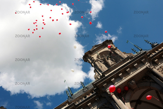 red balloons over the historic town hall