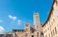 Historical architecture buildings, San Gimignano city Tuscany, Italy against blue sky