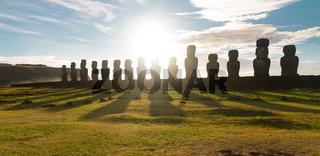 Sunrise over Moai stone sculptures at Ahu Tongariki, Easter island, Chile.