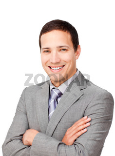 Assertive businessman with folded arms against a white background