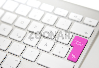 White computer keyboard with 'sale' button