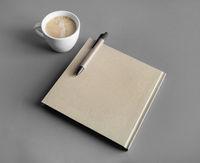 Brochure, pen, coffee cup