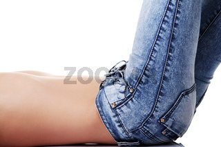 Fit female body in blue jeans