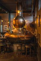 Large, copper fermentation vat in Bushmills whiskey distillery and bar as decoration