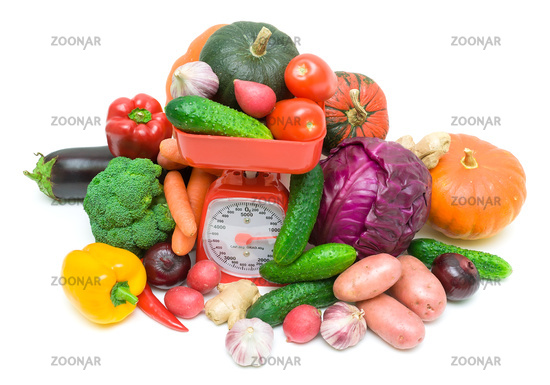 fresh vegetables and kitchen scales isolated on white background