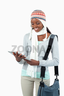 Smiling student in winter clothes with her tablet