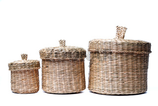 Three wattled baskets isolated on white