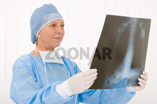 Senior surgeon female hold x-ray protective overall