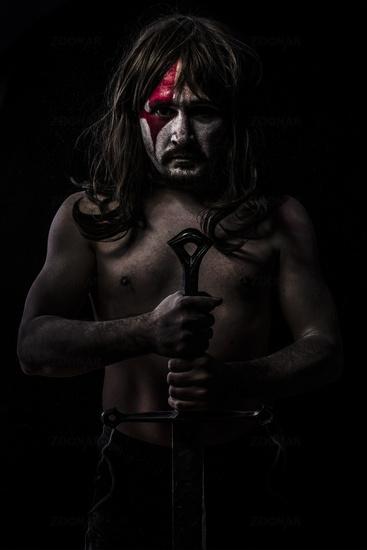 Warrior waiting, fight, medieval soldier with huge steel sword