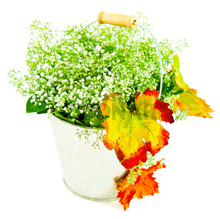 Bucket of autumn leaves  wildflowers