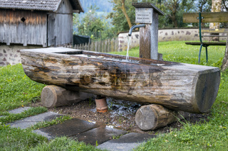 FIE ALLO SCILIAR, SOUTH TYROL/ITALY - AUGUST 8 : View of a wooden drinking water trough in Fie allo Sciliar, South Tyrol, Italy on August 8, 2020