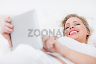 Young woman holding an ebook