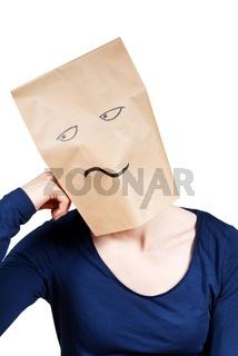 a person with a paper bag head symbolizing boredom